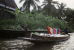 A merchant peddles her wares from a boat on a klong. People live on the klongs, boulevards of water that flow through the city like open veins,  and spend their lifetimes living in houseboats in Bangkok, Thailand. (Jim Bryant Photo).....