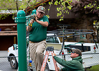 NWA Democrat-Gazette/JASON IVESTER<br /> Bill Beck (left) and Chris Little work to remove a damaged swing to be replaced Monday, April 17, 2017, at Dave Peel Park in Bentonville. The crew from Bentonville Parks and Recreation also repaired other playground equipment at the park.