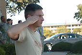 Fort Hood, TX - November 5, 2009 -- A first responder to a lone gunman's attack at Fort Hood, Texas, salutes after aiding his fellow soldiers, Thursday, November 5, 2009. .Mandatory Credit: Jason R. Krawczyk - U.S. Army via CNP