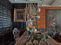 Traditional metal bowls in bronze and copper are from different centuries of Turkish culture, including the Ottoman period and twentieth century. The tiger statue is Art Deco. The painting depicting an Ottoman dog trainer figure is from the eighteenth century Italian school of Orientalist painting