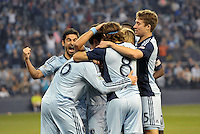Sporting KC players celebrate their opening goal..Sporting Kansas City defeated Montreal Impact 2-0 at Sporting Park, Kansas City, Kansas.