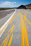 Helter-skelter painted barrier stripping road test patterns on paved pad along U.S. Highway 50y in rural Eureka County, Nev.