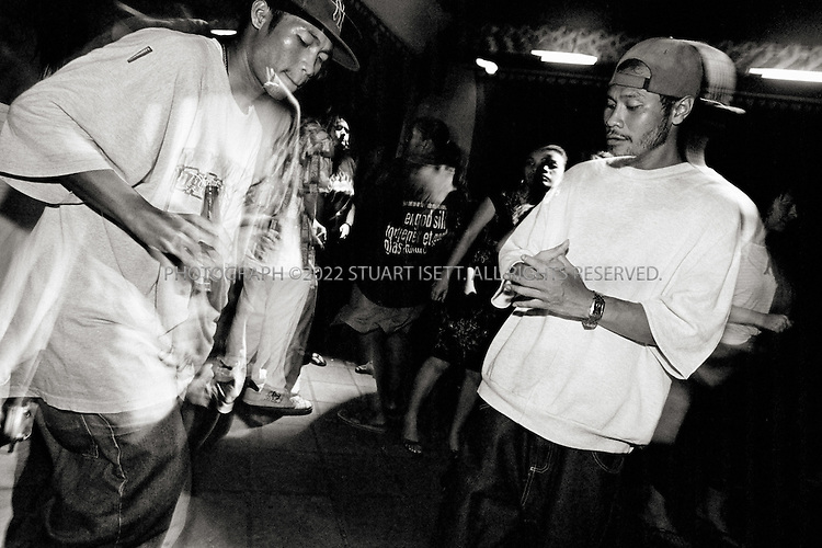 11/25/2006--Phnom Penh, Cambodia..Smiley (right) and another deportee dancing at the Riverhouse bar at 3 am...Photograph By Stuart Isett.All photographs ©2006 Stuart Isett.All rights reserved.