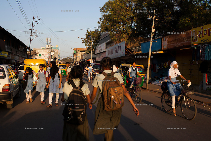 School girls cycle and walk home from school in Anand, Gujarat, India on 12th December 2012.  Photo by Suzanne Lee / Marie-Claire France