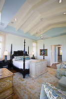 The master suite has a pop-up TV cabinet at the foot of the bed allowing for more windows to take in the beach views