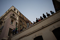 A group of egyptian protestors stand on a roof top of a building during violent clash with the security forces in central Cairo.