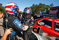 Mar 19, 2017; Gainesville , FL, USA; NHRA funny car driver John Force (left) greets runner up Jonnie Lindberg as he celebrates after winning the Gatornationals at Gainesville Raceway. Mandatory Credit: Mark J. Rebilas-USA TODAY Sports
