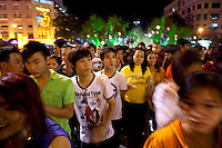 Vietnamese walk through downtown Ho Chi Minh City looking at the Lunar New Year decorations...Kevin German / LUCEO