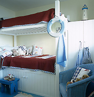 Ship-shape bunk beds and a blue and white colour scheme emphasise the nautical theme of this child's bedroom