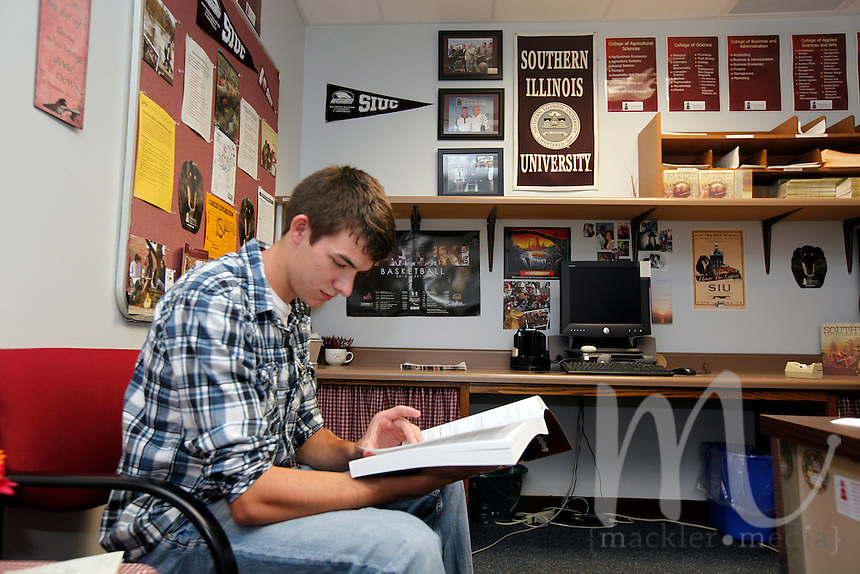 Brandon Tanner, of Vienna, Ill., looks through the Southern Illinois University's course catalog in the SIU Service Center located within Shawnee Community College in Ullin, Ill., on Wednesday, July 13, 2011. Tanner, who will be studying civil engineering beginning Fall 2012, hopes to complete his degree within two years. Seven SIU Service Centers such as this one have partnered with Illinois state community colleges in a pilot program where students in the program will apply and be accepted at the four-year institution, but complete their first two years at the community college.
