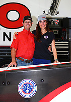 Apr 21, 2017; Baytown, TX, USA; NHRA top fuel driver Steve Torrence (left) poses for a photo with Taya Kyle , wife of US Navy sniper Chris Kyle in the pits during qualifying for the Springnationals at Royal Purple Raceway. Mandatory Credit: Mark J. Rebilas-USA TODAY Sports