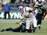 Minnesota Vikings quarterback Christian Ponder is brought down for a loss by Seattle Seahawks strong safety Jeron Johnson at CenturyLink Field in Seattle, Washington on  November 4, 2012.  Ponder completed 11 of 22 passes for 64 yards, was sacked four times and  had one pass intercepted in the Vikings 20-30 loss to the Seahawks.     ©2012. Jim Bryant Photo. All Rights Reserved.