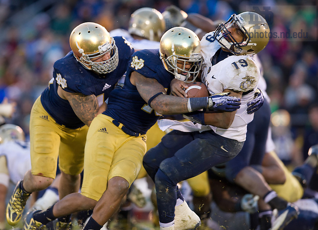 Nov. 2, 2013; Safety Eilar Hardy (16) hits Navy Midshipmen quarterback Keenan Reynolds (19) in the fourth quarter.<br /> <br /> Photo by Matt Cashore