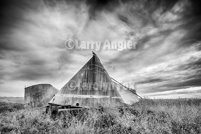 Collapsed abandoned grain storage tanks and storm, Carrizo Plain, San Luis Obispo County, Calif.