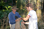 David & Sam Transfering Possum From Trap To Burlap Bag