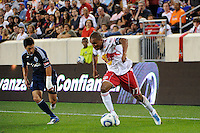 Juan Agudelo (17) of the New York Red Bulls is defended by John Thorrington (11) of the Vancouver Whitecaps. The New York Red Bulls and the Vancouver Whitecaps played to a 1-1 tie during a Major League Soccer (MLS) match at Red Bull Arena in Harrison, NJ, on September 10, 2011.