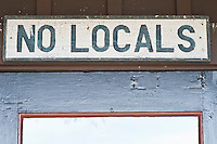 No Locals signage