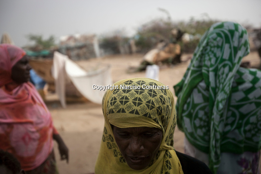 Tuesday 07 July, 2015: A displaced women from the heavy fighting in Haradh bordertown are seen in a temporary settlement at the outskirts of Beni Hassan in Hajjah province, Northwest of Yemen. (Photo/Narciso Contreras)