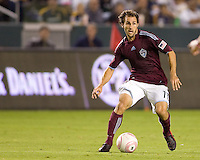 Brian Mullan of the Colorado Rapids moves with the ball looking for an open man. The Colorado Rapids defeated the LA Galaxy 3-1 at Home Depot Center stadium in Carson, California on Saturday October 16, 2010.