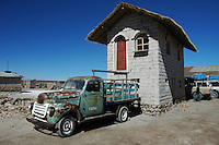 Salt house and old truck on the edge of the Salar de Uyuni, Potosi, Bolivia