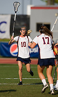 Kaitlin Duff (10) celebrates her goal with teammate (17) Brittany Kalkstein during the first round of the ACC Women's Lacrosse Championship in College Park, MD.  Virginia defeated Virginia Tech, 18-6.