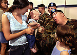 Brenda Johnson holds her son Ethan, 4, who puts the squeeze on Maj. Robert Fraser with daughter Mackenzie, 8, while in a receiving line. Fraser is 1 of 15 soldiers from the 41st BCT out of the Tigard Armory soon to be an Embedded Training Team serving as advisors for the Afghan National Army....