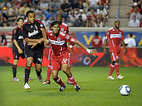 AC Milan midfielder Mancini (30) holds up Chicago Fire defender Wilman Conde (22).  AC Milan defeated the Chicago Fire 1-0 at Toyota Park in Bridgeview, IL on May 30, 2010.