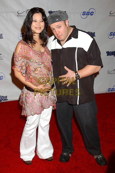 STEFFIANA JAMES & KEVIN JAMES.Tiger Jam VIII benefiting the Tiger Woods Foundation held at Mandalay Bay Resort & Casino, Las Vegas, Nevada.May 21st, 2005.Photo Credit: Laura Farr/AdMedia.full length touching stomach belly white trousers pink cut out shoulder flowing top hat black and white shirt.www.capitalpictures.com.sales@capitalpictures.com.© Capital Pictures.