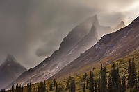 Evening clouds over Caliban mountain of the Arrigetch Peaks, Gates of the Arctic National park, Alaska.
