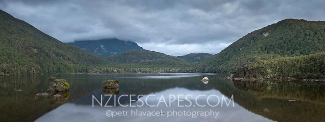 Dawn at mirror like Lake Sylvan, Mt. Aspiring National Park, Central Otago, New Zealand