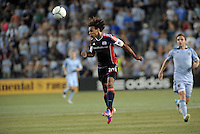 Kevin Alston (30) defender  New England Revolution heads the ball back to his goalkeeper..Sporting Kansas City and New England Revolution played to a 0-0 tie at LIVESTRONG Sporting Park, Kansas City, KS.