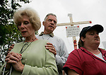 Ellen Martin (L) and her husband Jack (C), of Southhampton, Pa. pray for Terri Schiavo outside the Woodside Hospice on March 23, 2005 in Pinellas Park, Fla. Photo by Scott Audette/Reuters