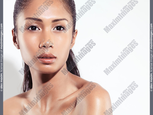 Closeup beauty portrait of an attractive young woman beautiful exotic asian face with healthy natural look isolated on white background
