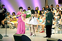 June 6, 2012, Tokyo, Japan - Atsuko Maeda gives flowers to Yuko Oshima, the first at election.  AKB General Election at Nippon Budokan. The biggest girl band in the world and Japan's most popular pop group elected its new leader in a nationwide election open to all fans. The collective is organised into different units which in turn are sometimes split into smaller groups. The night involved singing, games, tears and the eventual crowning of new leader Yuko Oshima from Team K with 108837 votes for most popular member..