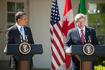 US President Barack Obama (L) looks on as Prime Minister Stephen Harper of Canada makes remarks during a joint press conference that included President Felipe Calderon of Mexico, in the Rose Garden of the White House in Washington DC, USA, 02 April 2012. President Obama hosted Canadian Prime Minister Harper and Mexican President Calderon for the North American Leaders' Summit (NALS). The leaders discussed cooperation on a variety of issues including economic growth, security, energy and climate change.