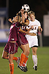 07 November 2008: Virginia Tech's Laurie Beth Puglisi (14) and a teammate challenge Virginia's Colleen Flanagan (24) for a header. The University of Virginia and Virginia Tech played to a 1-1 tie after 2 overtimes at WakeMed Stadium at WakeMed Soccer Park in Cary, NC in a women's ACC tournament semifinal game.  Virginia Tech advanced to the final on penalty kicks, 2-1.