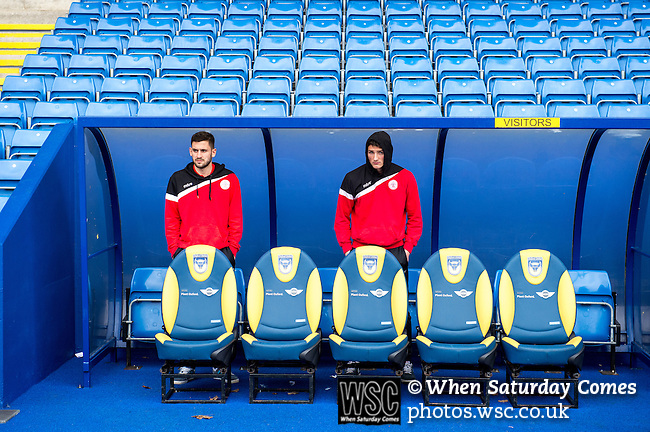 Oxford United 1 Accrington Stanley 2, 20/02/2016. Kassam Stadium, League Two. Two Accrington players shelter from the wind and rain an hour before kick off. Oxford's home ground is the Kassam Stadium in Oxford and has a capacity of 12,500. United moved to the stadium in 2001 after leaving the Manor Ground, their home for 76 years. Photo by Simon Gill.
