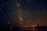 A view of the Milky Way and a Perseid meteor over Lake Michigan, Big Bay de Noc.