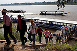 Tourists land in a small village in Laos during a tour of the Golden Triangle on the Mekong River in Sop Ruak, Thailand. Photo taken on Thursday, December 10, 2009. Kevin German / Luceo Images