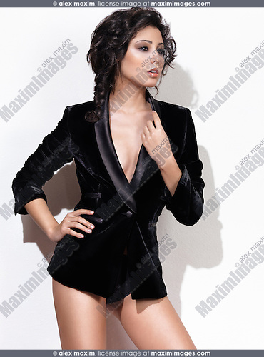 Fashion photo of a woman wearing a black blazer isolated on white background