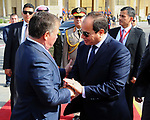 Egyptian President Abdel Fattah al-Sisi shakes hands with Jordan's King Abdullah II before he leaves the Egyptian capital Cairo,  on May 17, 2017. Photo by Egyptian President Office
