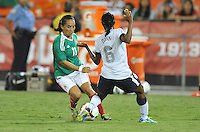 Monica Ocampo (11) of Mexico goes against Crystal Dunn (6)  The USWNT defeated Mexico 7-0 during an international friendly, at RFK Stadium, Tuesday September 3 , 2013.