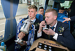 St Johnstone v Dundee United....17.05.14   William Hill Scottish Cup Final<br /> David Wotherspoon kisses the trophy and Brian easton kisses his beer on the journey back to P{erth<br /> Picture by Graeme Hart.<br /> Copyright Perthshire Picture Agency<br /> Tel: 01738 623350  Mobile: 07990 594431