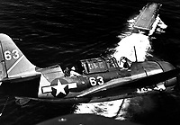 Aerial view of SB2C in upper landing circle showing USS YORKTOWN, below.  July 1944.  (Navy)<br /> Exact Date Shot Unknown<br /> NARA FILE #:  080-G-376123<br /> WAR &amp; CONFLICT BOOK #:  963