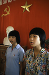 Members of the Young Pioneers sing  a hymn of praise to peace and Ho Chi Ming at the Dong Da Primary School in Hanoi, North Vietnam.  (Jim Bryant Photo)......