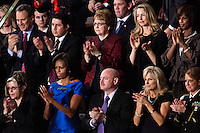 First Lady Michelle Obama, in the front row second from left, listens as President Barack Obama delivers his State of the Union address in the U.S. Capitol on Tuesday, January 24, 2012 in Washington, DC.