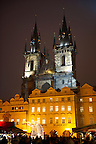 Christmas Market In Prague's Old Town Square with Church Of Out Lady Before Tyn at night