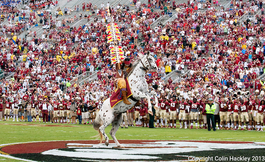 TALLAHASSEE, FLA 9/21/13-FSU-BCC092113CH-Osceola, portrayed by Florida State University student Drake Anderson, plants the spear at midfield before the Bethune-Cookman game Saturday at Doak Campbell Stadium in Tallahassee. <br />