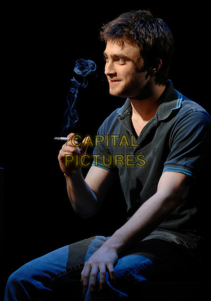"DANIEL RADCLIFFE.Photocall for ""Equus"" at the Gielgud Theatre, Shaftesbury Avenue, London, UK. .February 22nd 2007 .half length blue top grey gray smoking cigarette.CAP/PL.©Phil Loftus/Capital Pictures"