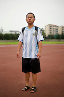 Bill Chenxiaohu, a student, age 23, poses for a portrait in Nanjing. Response to 'What does China mean to you?': '&quot;Central&quot; means &quot;moderate.&quot; China is a country that upholds the Buddhist Doctrine of the Mean. &quot;Mean&quot; is just normal.'  Response to 'What is China's role in the future?': 'This nation will rise up.'